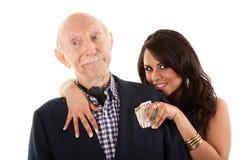 Mann mit Goldgräber Begleiter oder Frau stockbild