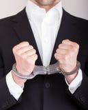 Mann mit Handschellen, Anzug lizenzfreies stockfoto
