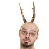 Mann mit Hupen auf Kopf Stockbild
