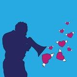 Mann mit Lautsprecher, Herzen, die vom Lautsprecher erlöschen Stockbild