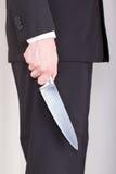 Mann mit Messer, Anzug lizenzfreie stockfotografie