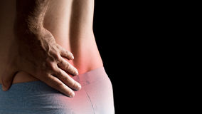 Mann mit niedrigeren Rückenschmerzen Lizenzfreie Stockbilder