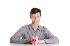 Mann mit piggy Querneigung Stockfoto