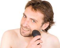 Mann mit Rasierapparat Stockbilder