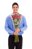 Mann mit Rosen Stockfotografie