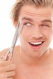 Mann mit Scherblock stockbild