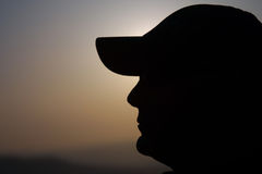 Mann mit Schutzkappe silhouete Lizenzfreies Stockbild
