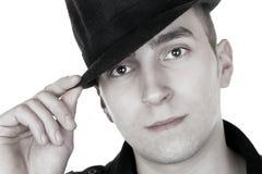Mann mit schwarzem Hut Stockbild