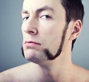 Mann mit Sideburns Stockfoto