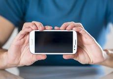 Mann mit Smartphone Stockfotos