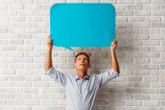 Mann mit Sprache-Blasen Stockbilder