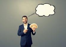 Mann mit Spracheblase und -geld Lizenzfreies Stockbild