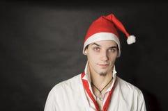 Mann mit Weihnachtshut Stockbild