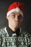 Mann mit Weihnachtshut Stockfotografie