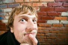 Mann mit weit offenen Augen Stockbilder
