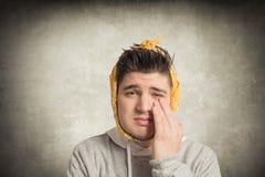 Mann mit Zahnschmerzen Stockfotografie