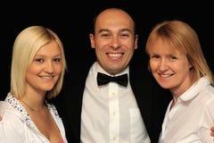 Mann mit zwei Frauen Stockbilder