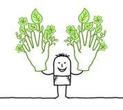 Mann mit zwei großen grünen Händen Lizenzfreie Stockfotografie