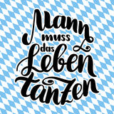 Mann muss das Leben tanzen. Vector hand-drawn brush lettering illustration isolated on white. German quotes for Stock Photos