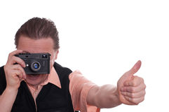 Mann with range finder camera. Male photographer with a range finder camera is holding up his thumb Stock Photo