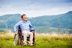 Mann in rolstoel Stock Afbeeldingen
