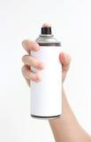 Mann ` s Hand hält einen Spray der schwarzen Farbe Lokalisiert auf einem weißen BAC Stockfotografie