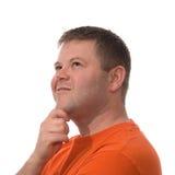 Mann schaut oben auf Weiß getrennt Stockfotografie