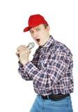 Mann schreit zum Mikrofon Stockfotos