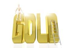 Mann sitzt auf einem enormen goldenen Wort GOLD Lizenzfreie Stockfotos