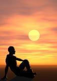Mann am Sonnenuntergang lizenzfreies stockfoto