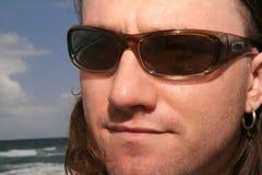 Mann am Strand Stockfotos
