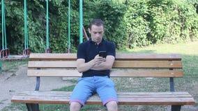 Mann toouching Smartphone stock video