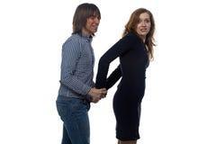 Mann und blonde Frau mit Paaren Handschellen Stockfotos