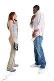 Mann und Frau, die an den Telefonen sprechen Stockbild