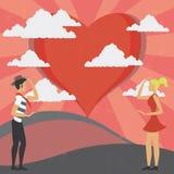 Mann und Frau, die die Liebe anstarren Stockbild