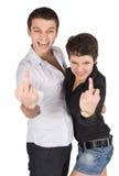 Mann und Frau, die mittleren Finger zeigen Stockbild