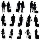 Mann und Frau mit Reisetaschenschwarzem Stockbild