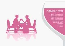 Mann und Frau am Tisch Lizenzfreie Stockfotos