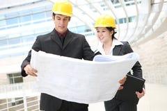 Mann-und Frauen-Architekten lizenzfreies stockbild