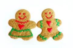 Mann-und Frauen-Weihnachtslebkuchen-Plätzchen lokalisiert auf Weiß Lizenzfreies Stockbild