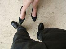 Mann- und Frauenfahrwerkbeine Stockfotos