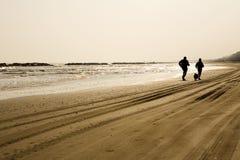 Mann- und Frauenlaufen im Freien Stockbilder