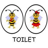 Mann- und Frauentoilettenzeichen. Lustige Karikaturbienen Stockfotos
