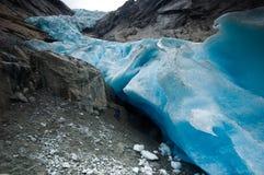 Mann und Gletscher Lizenzfreie Stockbilder