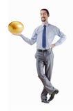 Mann und goldenes Ei Stockfotos