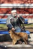 Mann und Hund Lizenzfreie Stockfotos