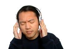 Mann und Music.Isolated Stockbilder