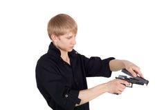Mann und Pistole Lizenzfreie Stockfotos