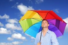 Mann und Regenschirm Stockfotografie