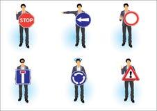 Mann und sechs Verkehrsschilder Stockbild